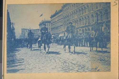 Brigadier General Otis and staff marching down Market Street to embark for the Phillipines