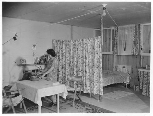 A typical interior of a barracks home. Photographer: Parker, Tom Denson, Arkansas