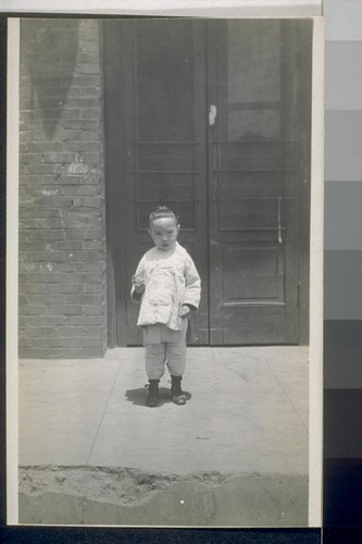 Chinatown, Los Angeles. 1911. [Child in front of unidentified building.]