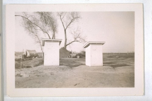 Spring, 1936, Kern County. Showing Public Health toilets put up as a result of orders to improve sanitary conditions at the Frick squatter camp