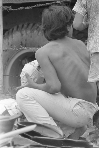 Wrapping clay pieces, La Chamba, Colombia, 1975