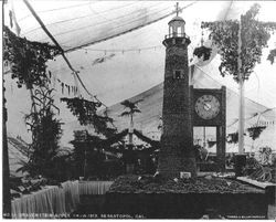 Gravenstein Apple Show displays in 1913 of a lighthouse sponsored by the Jonive District, a dirigible and a Stony Point sign
