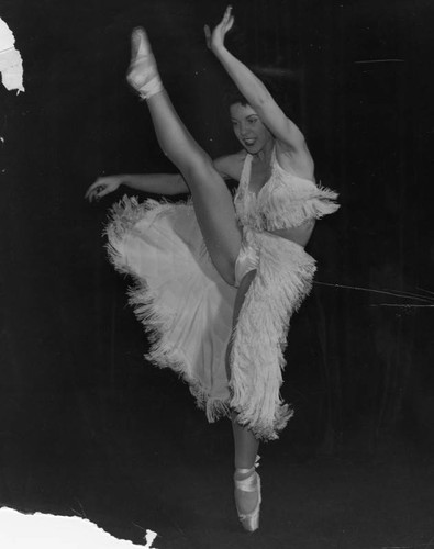 Young dancer with a high leg kick
