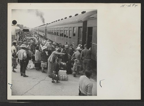 A scene at Delta, Utah, as passengers from the Topaz Center entrain for Tule Lake on trip 15. Photographer: Mace, Charles E. Topaz, Utah