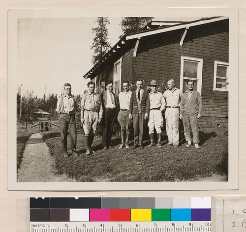 [Robert Marshall with other men outside laboratory building.]