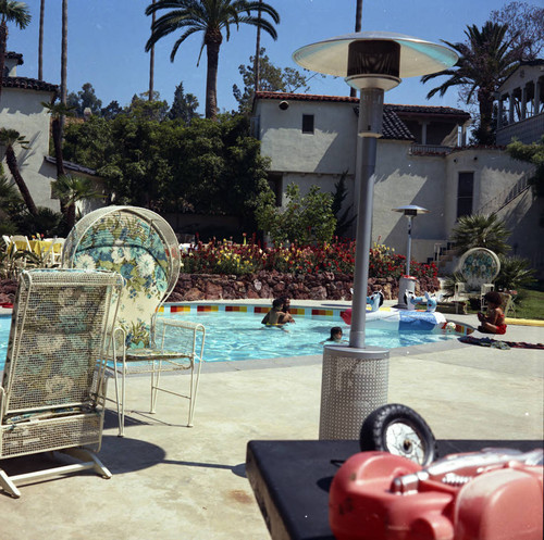 Guests in the pool at Berry Gordy's house party, Los Angeles
