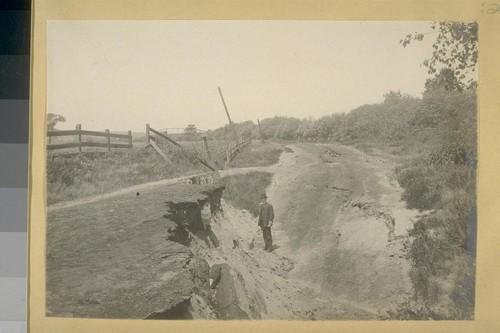 [Large bank of fissure and fence damage.]