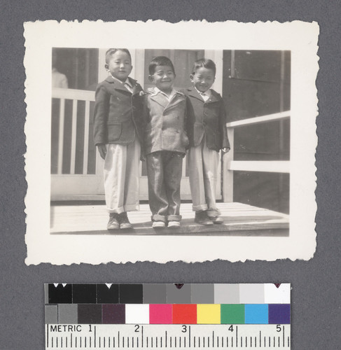 Portrait--three boys #4 [on porch]