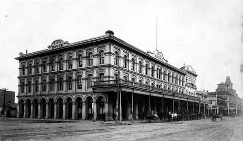 Photograph taken of the Pico House at the corner of Plaza and Main Streets with a wagon and horse in front