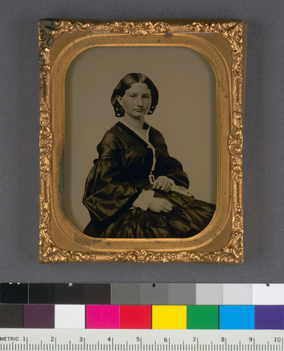[Seated unidentified woman.]