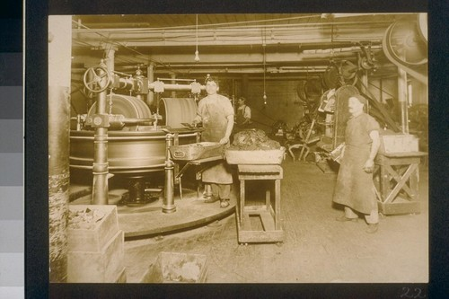 [Factory workers and machinery.]