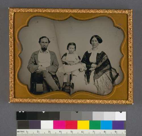 [Unidentified man, woman and child.]