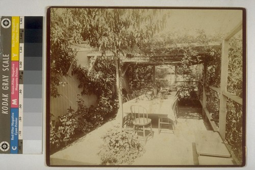 [Outdoor dining area. Residence of Isaiah West Taber. Photograph by Isaiah West Taber.]