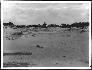 Footprints lead up the beach to the Point Pinos Lighthouse, Monterey County, 1900