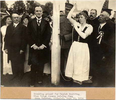 Breaking ground for Danish Building, Miss Helga Jensen raising flag, Otto Wadsted, Official. Sept. 15, 1914.