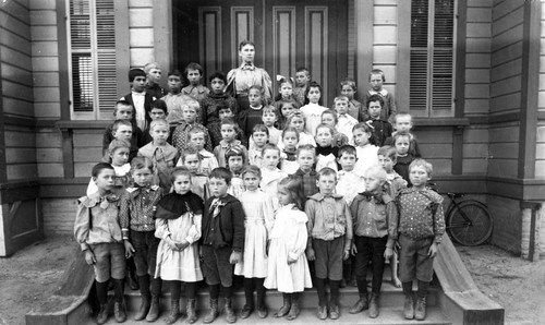 Mrs. McCharles and her grammar school class on the steps of the Tustin Public School, ca. 1900