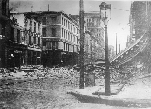 [Ruins and rubble along Commercial St.]
