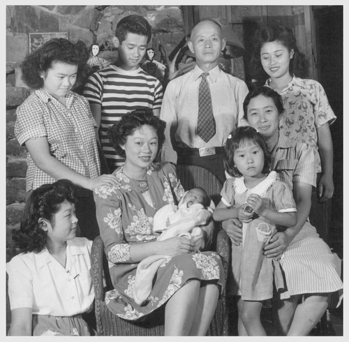 The Yamasaki family from Granada Relocation Center pose for their picture. From left to right, standing in back, Edith, Jim