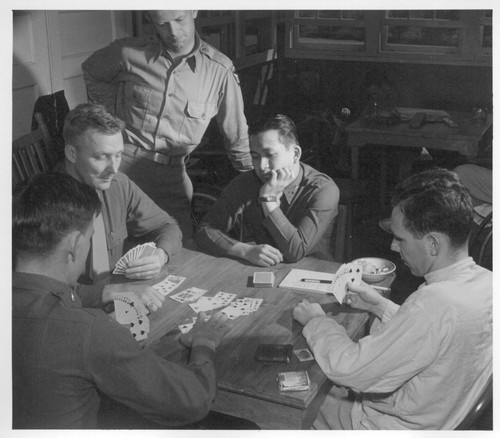 1st Lt. Shigeru Tsubota playing bridge with other officer patients at the Moore General Hospital, Swannanoa, North Carolina. Lt. Tsubota was wounded in the leg by shrapnel while serving with the 100th Battalion in Italy. He is a graduate of the University of Hawaii and did post graduate work in vocational education, specializing in agriculture. He was commissioned as a 2nd Lt. in the reserve in Jan., 1940, called into active service in March 1941 and promoted to 1st Lt. in August, 1942.--Photographer: Van Tassel, Gretchen--Swannanoa, North Carolina. 4/19/44