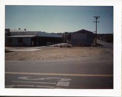 View of the O. A. Hallberg & Sons Apple Products cannery receiving area and cold storage from Graton Road and Bowen Avenue, Graton, California, about 1960s