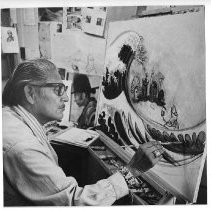 Carl Gorman, noted Navajo artist and former director of the Navajo Culture Center, works on one of his canvases