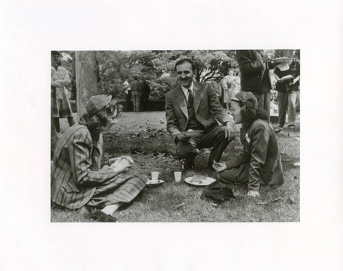 Dr. Pullias with two students at a picnic