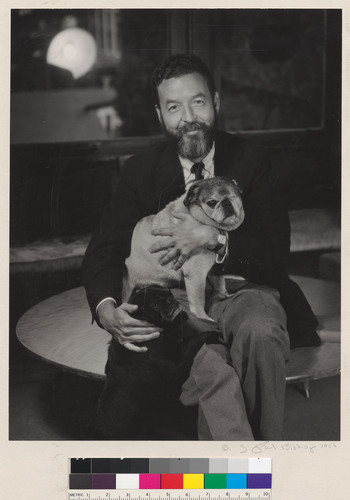[Writer Randall Jarrell with two pug dogs.]