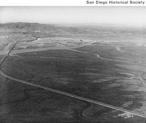 Aerial view of a curving road and two bridges at Mission Bay leading to Crown Point