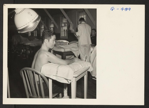 Pvt. Kenichi Kawakami receives physio-therapy treatments at the Moore General Hospital, Swannanoa, North Carolina. Pvt. Kawakami was serving with the
