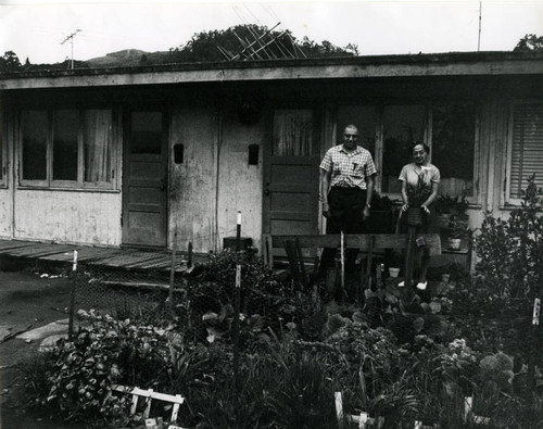 Long-time Marin City resident and community leader Jesse Berry and his wife Flossie, in front of World War II-era housing, circa 1960 [photograph]