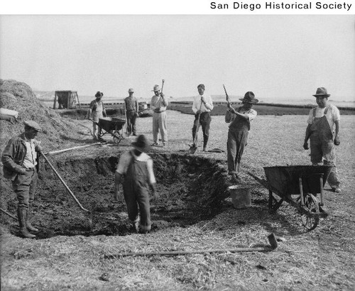 Adobe brick makers around a large mud pit used to make adobe bricks for the Shore Acres Country Club