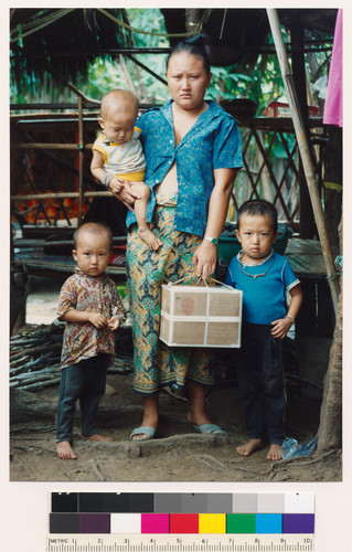 Hmong mother and sons holding parcel from relatives in Fresno, California