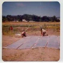"Photographs of Bolinas Bay. ""Covering archaeological dig, Bolinas Lagoon, 8-21-74."""