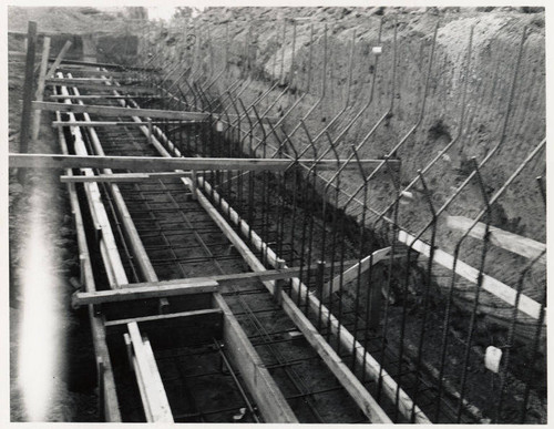 Construction of the Santa Monica Municipal Pool showing copper water stop and pipe chase in footing, July 25, 1950