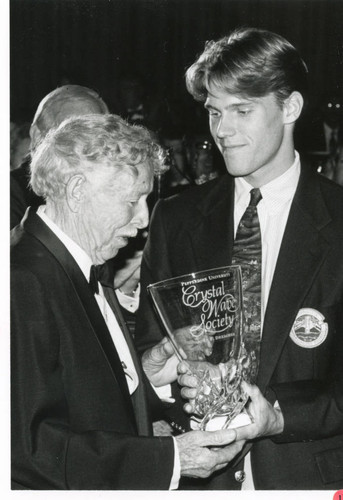 Photograph of John F. Drescher receiving the Crystal Wave Society Trophy at the Associates Dinner