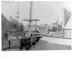 View of the P&SR railway over rooftops, looking west on Main Street, Sebastopol, about 1920