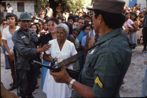 Soldiers maintain order at a polling place, Santa Tecla, La Libertad, 1982