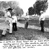 From the left: Don A Latta, Sue Roark, Robert F. Lee, and Dwain Blyseth, cemetery officials from other cemeteries look over area where they say some 75 graves once were