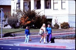 Three unidentified Analy High School students at the intersection of Wallace Street and North Main Street, Sebastopol, California, about 1970
