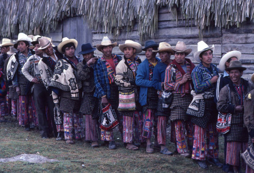 Mayan men wait in line to vote, Guatemala, 1982