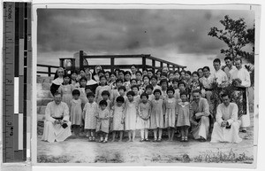 Group of girls picnicing at Maryknoll Karazaki, Japan, ca. 1937