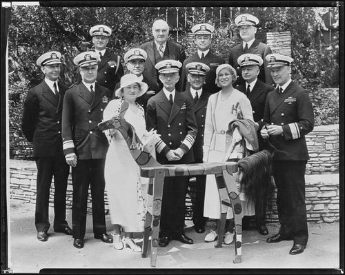 Peggy Hamilton, Clara Schofield, Burr McIntosh and ten Navy admirals at the Breakfast Club, Los Angeles, 1932