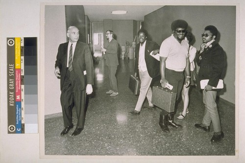 (Left to right) Charles Garry (attorney), Dick Hallgren, Donnell Langford, Charles Bursey, Terry Cotton. Municipal Court, Oakland