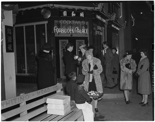 Crowd outside Forbidden Palace restaurant in Chinatown, Los Angeles, 1930s  — Calisphere