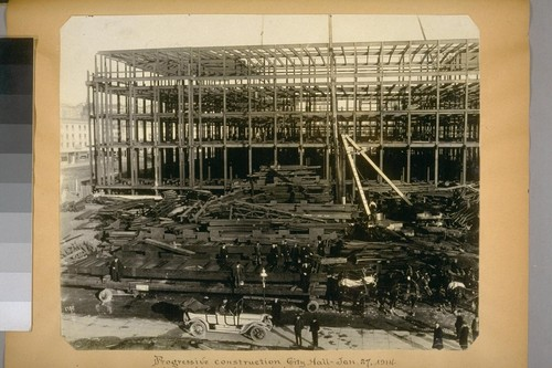 Progressive construction, City Hall. Jan. 27, 1914. (Unloading 46 ton girders used in dome.) 1712