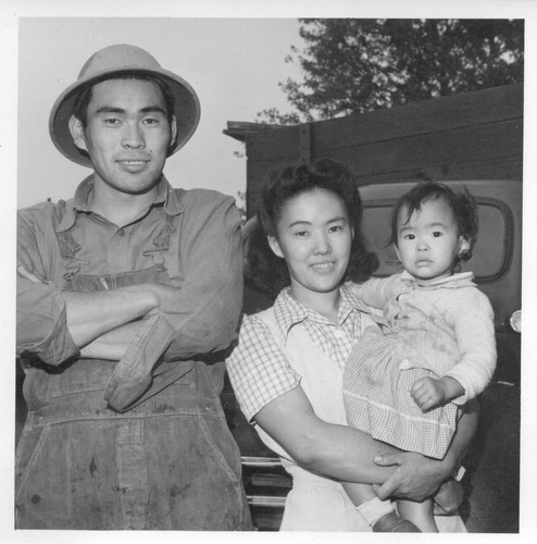 Shibo Hayashi, his wife Kimiye, and daughter Kuye formerly of Rohwer and San Pedro, California, stand by the truck which