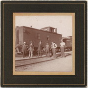 [Southern Pacific wood caboose with train crew]