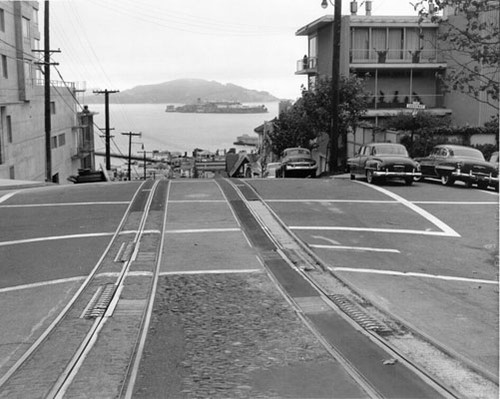 "[Hyde at Chestnut with view of Alcatraz, ""The Rock,"" in the distance]"