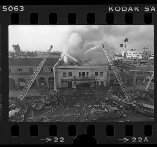 Firemen fighting blaze at Star Theater at 5446 Hollywood Blvd. in Los Angeles, Calif., 1976