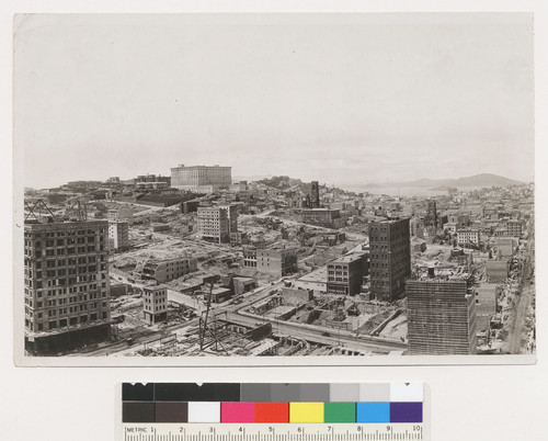 S.F. 1 year after fire. Panorama north from. Chronicle, Kearny & Telegraph Hill in center. [Caption refers to original panoramic view, before photo was torn. Nob Hill and Fairmont Hotel, left center; Russian Hill in greater distance center; Grace Cathedral, center; St. Mary's Church, right center.]